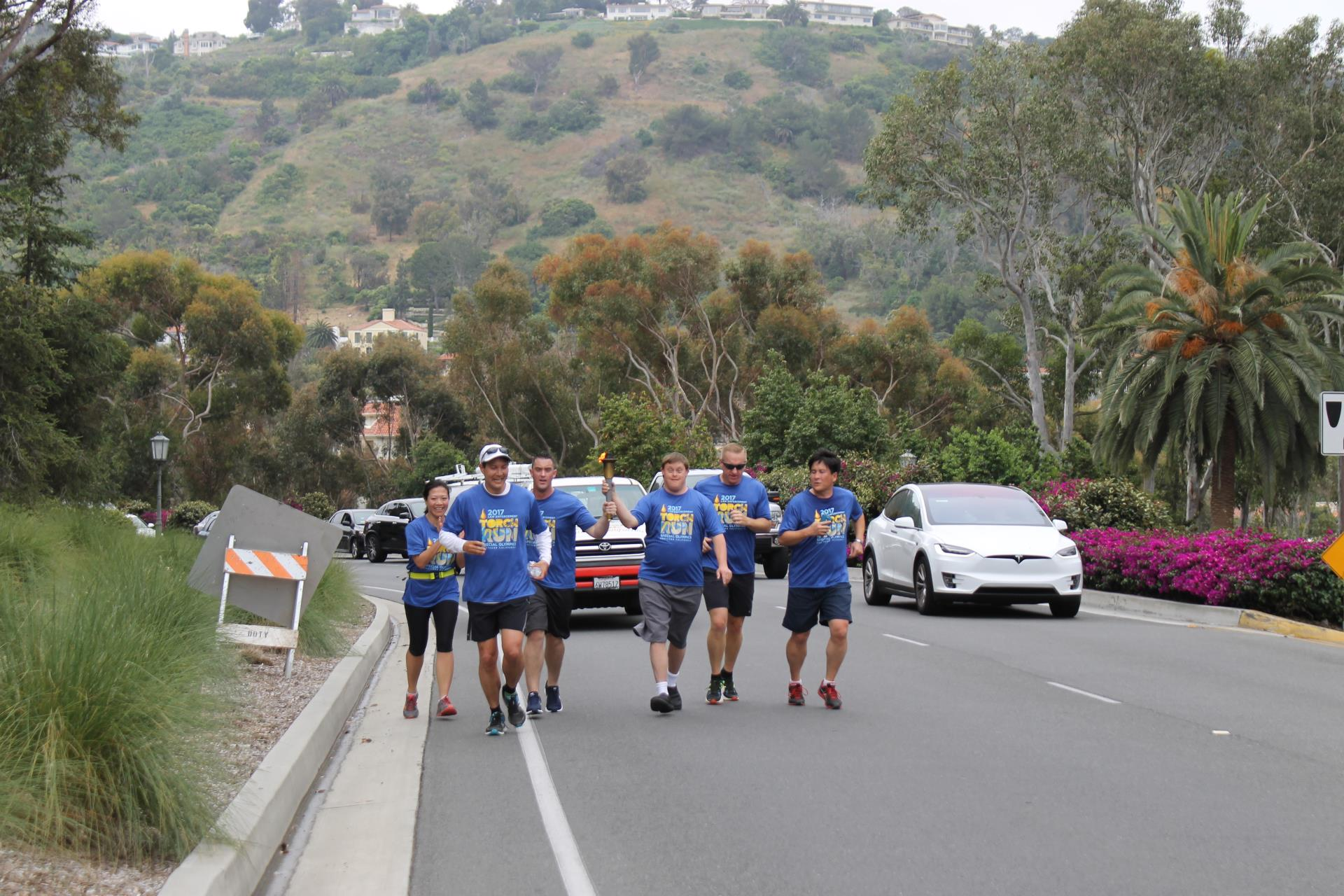 Runners coming up Palos Verdes Drive West to Palos Verdes Boulevard